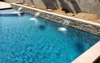 Finest Finish Radiant Fusion Indigo Crush Pool with water feature