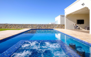 Finest Finish Sparkle Quartz Laguna pool with water feature and seating