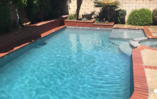 Finest Finish Micro Fusion Tahoe pool with brick coping