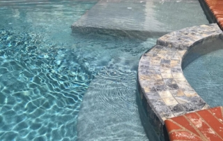 Finest Finish Micro Fusion Tahoe pool with brick coping steps, ledge and spa