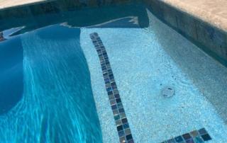 Universal Mini Pebble - Laguna White pool steps with tile