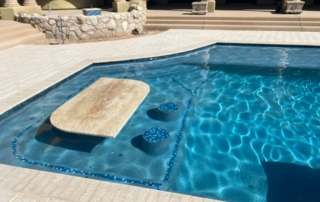 Radiant Fusion Regal Blue pool with in pool table and seating