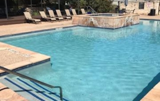 Finest Finish Blends Texas - Blue Star white swimming pool with spa perspective from pool steps 2