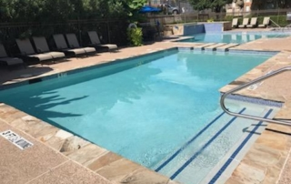 Finest Finish Blends Texas - Blue Star white swimming pool with spa perspective from pool steps