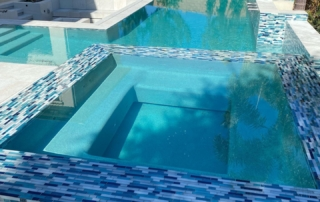 Micro Fusion Turquoise with blue, white and turquoise tile trim spa