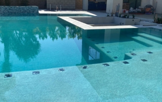 Micro Fusion Turquoise Pool with spa and shelf - tile detail