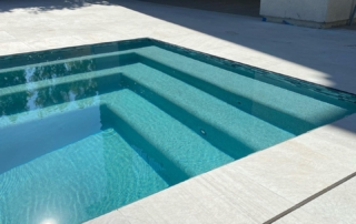 Micro Fusion Turquoise pool steps white decking and tile trim