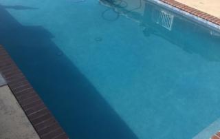 Universal Mini Pebble Agua Azul pool spa and ledge with brick coping