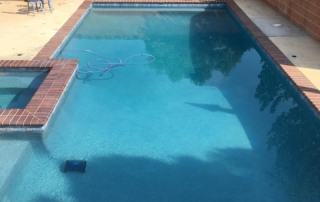 Universal Mini Pebble Agua Azul pool with brick coping