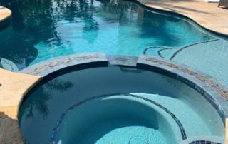 Universal Mini Pebble Laguna Blue pool with spa baja shelf rounded steps and blue tile detail