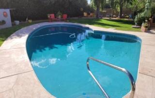 Universal Mini Pebble Laguna Blue pool with steps and handrail