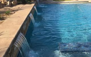 Universal Mini Pebble Laguna with glass pool water feature