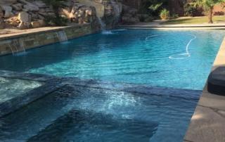 Universal Mini Pebble Laguna with glass spa and pool with slide