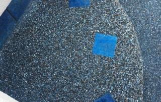Universal Mini Pebble Midnight pool step with blue tile