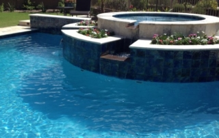 Finest Finish Sea blue spa with water feature and flowers