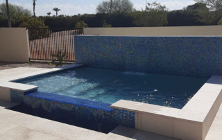 Finest Finish pool with water feature and tile wall - Universal Mini Pebble Laguna White