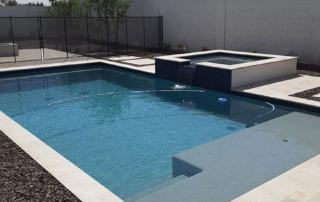 Laguna Blue pool with square spa and baja shelf